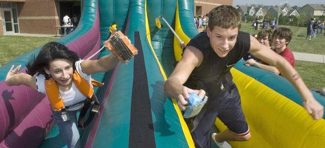 During a pre-homecoming celebration Friday, Mill Valley students decorated floats and had activities outside the school building. Becca Uthe (left) and Jonathan Spano competed in a bungee velcro race.