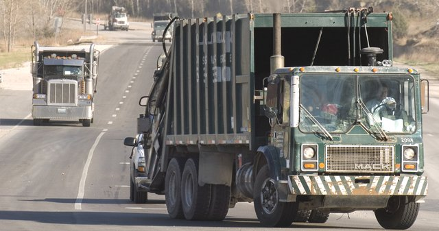 Deffenbaugh trucks return to the Johnson County Landfill entrance on Holliday Drive.