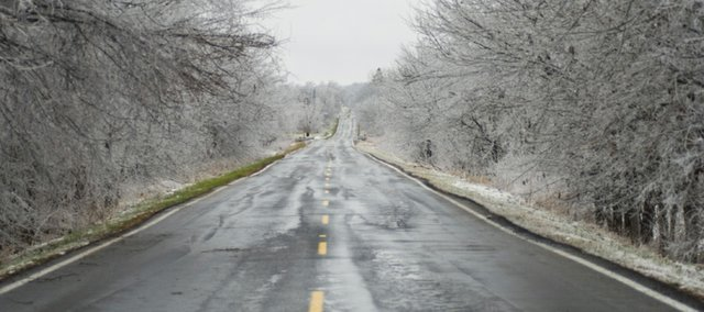 Trees along County Road 6 are covered in a layer of ice after rainfall Monday and Tuesday, but the roadway escaped the icy glaze. Despite some scattered power outages, Tonganoxie and its immediate surroundings were missed by the brunt of the storm's first 24 hours.