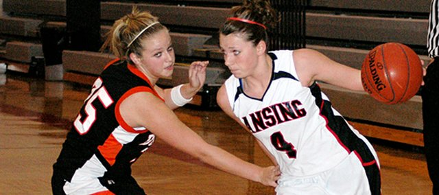 Lansing High senior Katie Nietzke drives to the basket against Bonner Springs' Kelsey Stanbrough.