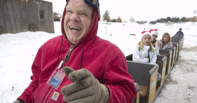 The ride on the Santa's Express is open-air, but that doesn't matter to train engineer Larry Crouse. Despite the cold December air, Crouse had a hearty laugh and warm gloves to keep him going through the frigid wind chill once the train started rolling.
