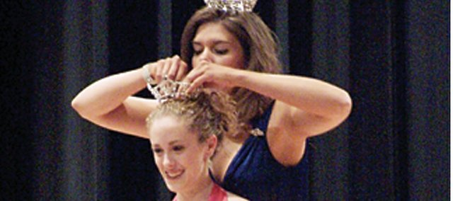 Basehor-Linwood High School freshman Jessica Farris is crowned Miss Leavenworth County Teen by Carol Toland, Miss Kansas River Valley 2007, during the Miss Leavenworth County, Miss Wooded Hills and Miss Leavenworth County Teen Pageant on Saturday at BLHS. Farris, a first-time teen pageant contestant, is now eligible to compete in the Miss Kansas Outstanding Teen Pageant in February in Wichita.