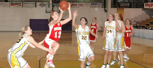 THS guard Christy Weller slashes to the basket Friday against St. Teresa's Academy at Mabee Fieldhouse in Kansas City, Mo. THS lost, 54-45.
