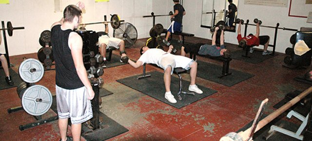 Lansing High students work out in the LHS weight room on Friday afternoon. The results of former Senate Majority Leader George Mitchell's investigation into steroid use in Major League Baseball were released Thursday, Dec. 13. Many in the Lansing baseball community expressed their disappointment in the pros for using means other than lifting weights and working out to achieve success on the field.