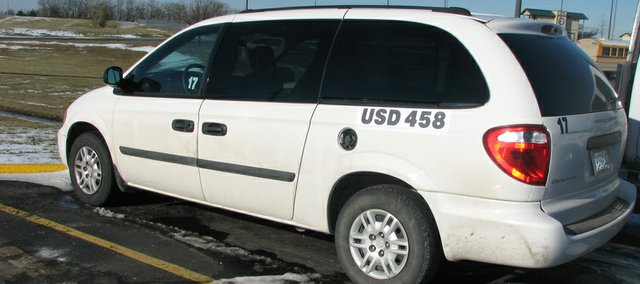 A Basehor-Linwood school district van parked outside the district's central office is one of several missing its gas cap cover after two juveniles were caught vandalizing the vans late last month.