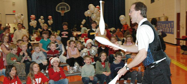 """Juggling Jeff,"" of Liberty, Mo., entertains Lansing Elementary School students Saturday morning during Breakfast with Santa, an event sponsored by the LES/LIS PTA."