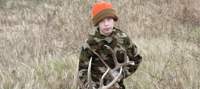 THS freshman Jacob Ostermeyer catches the deer he shot at a park in Osage City earlier in the month. The deer weighed in at more than 200 pounds at Cabela's in Kansas City, Kan. Its antlers were 178 inches long.