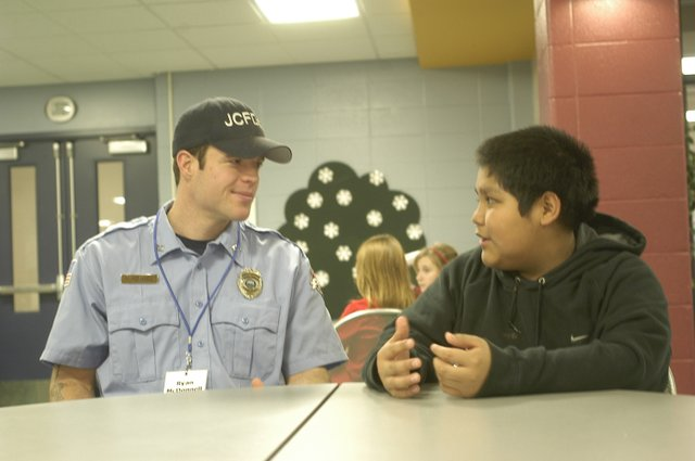 YouthFriend Ryan McDonnell and sixth-grader Oscar Chavez caught up with each other Friday before breakfast.