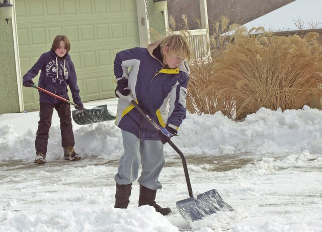 Brendan Clouston and Logan Clancy took advantage of the holiday school break and last week's snow to earn extra money by shoveling driveways in the Timber Lakes subdivision. If forecasts hold, De Soto and the region will get a respite from the near monthlong grip of winter weather that produced a white Christmas.