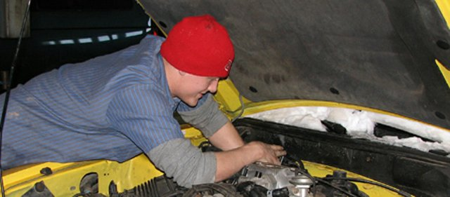 Sutton-Kolman Automotive owner Bob Kolman recommends vehicles be inspected as soon as possible to prepare drivers for the rest of the winter season. In this photo, mechanic Corey Doughty works on a car Friday at Sutton-Kolman in Basehor.