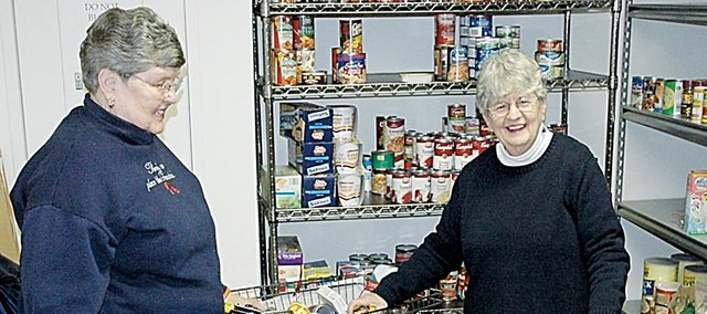 Ruth Dickinson, left, and Delma Hitchcock look over the bountiful supply of food that's currently in the First United Methodist Church's Food Pantry. The pair help out with the project that provides food to those in need.