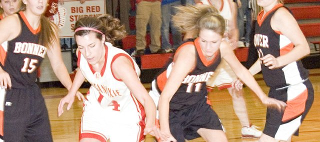 Tonganoxie senior Liz Baska and Bonner Springs senior Chelsea Crouch battle for the ball in Friday's game at Tonganoxie High. THS defeated Bonner Springs, 53-46.