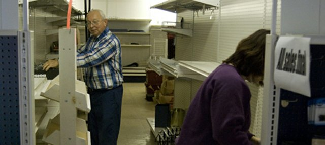 Don Pelzl and Beth Tiner tear down shelves at the building that housed Pelzl&#39;s hardware and variety store for 29 years. Matt and Vicki Bichelmeyer are going to buy the building and use the space for a banquet room and two retail stores. 