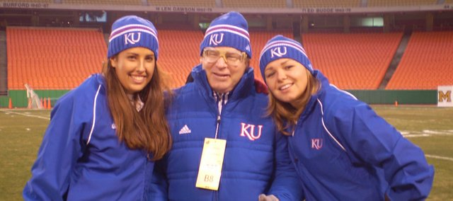 "McLouth High alumnae and Kansas University sophomores Kyrstan Perry, left, and Claudia Alterman, right, visit with Todd ""Leaper"" Williams before the Kansas-Missouri game at Arrowhead Stadium."