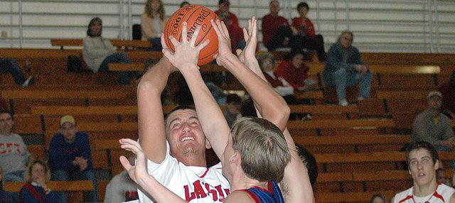 Lansing High junior Cody Rush puts up a guarded shot during Lansing's 71-46 victory over Santa Fe Trail.