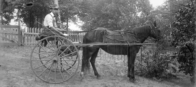 Urbin Rudell also set up his camera to take a self-portrait  with his delivery buggy and horse.