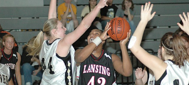 Lansing High junior Alexis Ellis puts up a shot in the post during Lansing's 62-30 victory over Turner.