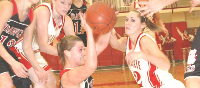 Tonganoxie senior Shannon Carlin gets on the floor for a loose ball against Rossville on Tuesday in the Tonganoxie Invitational. THS defeated Rossville, 50-43.