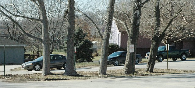Vehicles line the street on Hithergreen Drive, just south of Lansing Intermediate School. A group of Hithergreen residents has asked the Lansing School Board to come up with a way to try to limit parking by students on the street.