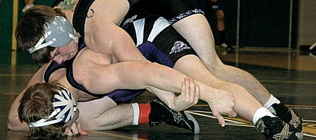 Baldwin High School senior Kevin Callahan, top, scores a takedown during this 130-pound championship match Saturday at the Bobcat Classic. Callahan won the title on the same day he became the all-time leader in career wins at BHS, passsing 2004 BHS graduate Kyle Flory with 153 victories.