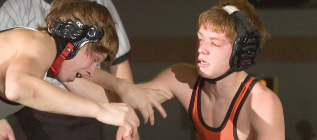 Caleb Seaton (right) of Bonner Springs comtinued with his winning style in the 103-weight division by defeating Michael Provencher of Rossville.