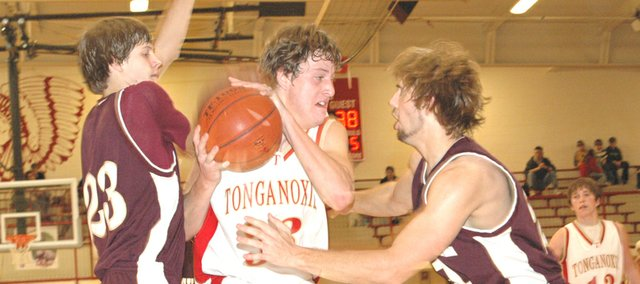 Tonganoxie junior center Austin Smith looks for an opening to the basket in Thursday's consolation semifinals match-up against Silver Lake. THS lost the game, 49-42.