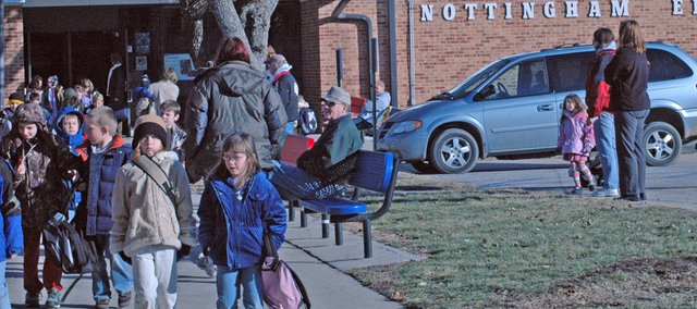 Parents wait as students file out of Nottingham Elementary School Tuesday afternoon. Though the new elementary school will not be open until fall 2009, the Eudora USD 491 School Board has begun to look into options it has with the Nottingham property, as well as others such as the Community Learning Center and Laws Field.
