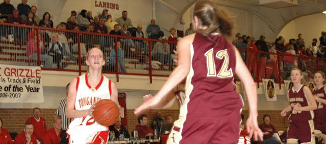 Tonganoxie senior guard Christy Weller drives for a layup in Friday's semifinals against Silver Lake. Tonganoxie won, 41-36.