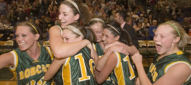The Basehor-Linwood girls basketball team explode in jubeliation after defeating Platte County 65-51 Saturday night.