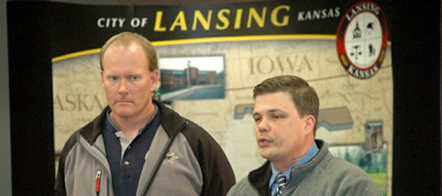With Lansing Police Chief Steve Wayman, left, looking on, Leavenworth Acting Police Chief Pat Kitchens addresses the media during a news conference Wednesday, Jan. 23, at Lansing City Hall. Kitchens announced authorities were  detaining a &quot;person of interest&quot; in the fatal shooting of Olivia Jackson. The 20-year-old Jackson, who was pregnant, was shot to death at a Lansing mobile home park Tuesday, Jan. 22.