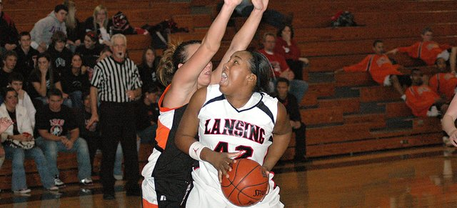 Lansing High junior Alexis Ellis muscles her way to the basket against Bonner Springs' Felisha Leipard during Lansing's 52-43 victory Friday night.