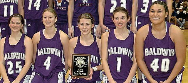 Members of the Baldwin High School girls' basketball team celebrate their third-place finish in the 18th-annual Top Gun Tournament Saturday night. Baldwin beat Kansas City Piper 50-49 to place third. Pictured front row, from left, are seniors Callie Craig, Courtney Harris, Colby Heckathorne, Heather Garcia and Ashley Tucker. Back row are freshman Allison Howard, junior Tracie Weege, freshman Ramie Burkhart, junior Calleigh Durr, sophomore Connor Twombly, junior Alex Zordel and junior Clare Miles.