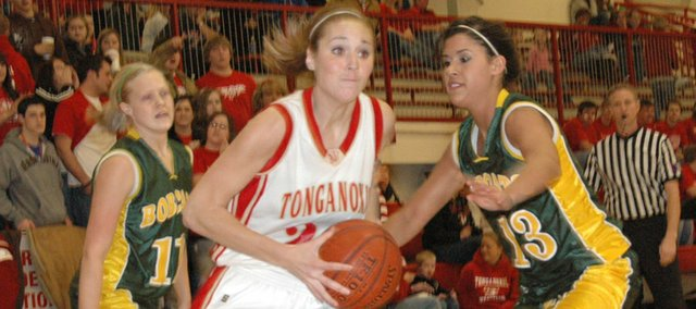 Tonganoxie senior forward Shannon Carlin slashes to the basket against Basehor-Linwood on Friday at the THS gymnasium. The Chieftains overcame a nine-point deficit with 2:50 left in the fourth quarter and won, 50-44, in overtime.