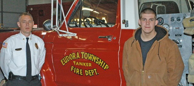 Eudora Township Fire Chief Mike Baxter and township firefighter Justin Robertson stand in the garage of the Eudora Township Fire Department. The department is recruiting 