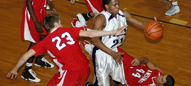 Piper's Jamal Jarrett slashes through the Lansing defense on his way to the basket.