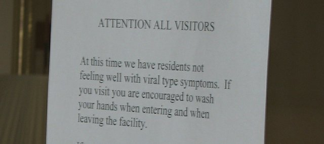 A sign on the door of the Tonganoxie Nursing Center informs visitors that several residents and staff members have not been feeling well with viral symptoms.