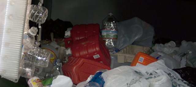 Empty water bottles, detergent containers and plastic bags fill the plastic only recycling bin installed by Honey Creek Disposal inc. in the parking lot of Triple Creek Realty. Kevin Weldon, owner of Honey Creek Disposal, said he wanted the new recycling center to help Tonganoxie residents to start living a greener life and reduce the amount of waste put into the new 95-gallon trash containers. 
