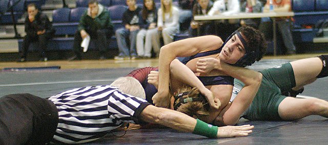 "Eudora's Jon Chumbley wrestles Jan. 31 at Eudora's ""Raise the Roof"" double dual wrestling event. The Cardinals beat both De Soto and Anderson County on the night."