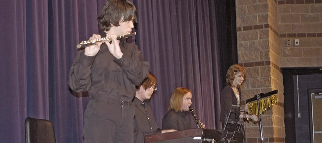 The Scott Ireland Project performs their winning composition written by the band's namesake at the De Soto High School Idol talent show last Thursday at the high school The band members are Tommy Strauser on flute, Ireland on the keyboard, Katie McKeirnan on clarinet and Crystal Wolf on chimes.