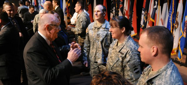 Kansas University Chancellor Robert Hemenway talks with wounded soldiers Wednesday at Fort Leavenworth. A new program will allow wounded soldiers to earn their master's degrees at  KU while remaining in the Army.