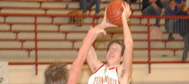 THS junior Austin Smith drives the lane for a layup against Santa Fe Trail on Feb. 5 at the THS gymnasium.