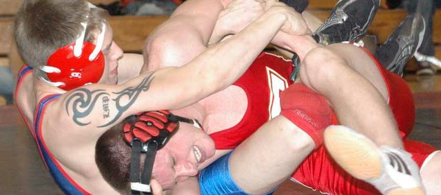 Tonganoxie High senior Matt Ditty tries to escape the hold of Santa Fe Trail's Allen Rasmussen at Saturday's Kaw Valley League Wrestling Championships at Lansing High School. Tonganoxie finished third out of nine teams.