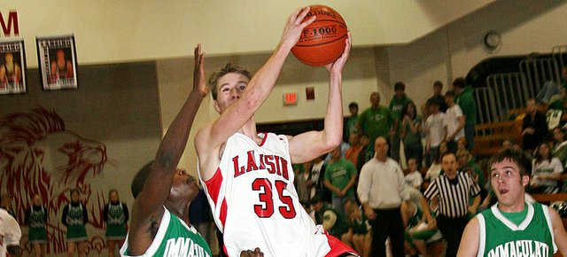 Lansing High junior Clayton Hall goes up for a layup during Lansing's 77-63 victory over Immaculata.