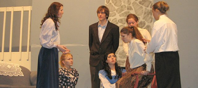 "Basehor-Linwood High School students Hannah Rollwagen, Brittany Laney, Kyle Allen, Nicole Theno, Andrea Adcox, Christina Self and Chelsie Pike rehearse a scene from ""Little Women"" during dress rehearsals Tuesday evening."