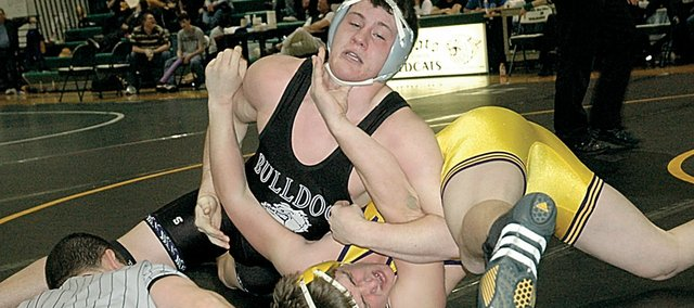 Baldwin High School senior Gabe Mason, left, was seconds away from pinning Spring Hill's Cody Spader to win the 171-pound weight class at the Frontier League wrestling tournament Saturday. Mason was Baldwin's lone champion as the Bulldogs finished second for the third consecutive year.