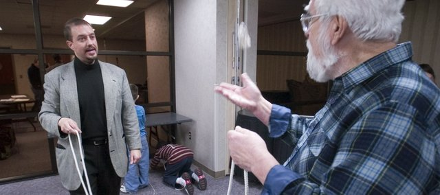 Magician Keith Leff (left) explains some of the tricks of the trade to students Don Robinson during a recent class session at the Shawnee Civic Centre.