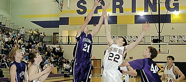 Baldwin High School junior Brandon Tommer (No. 21) competes for a rebound with Spring Hill's Ryan Bontrager (No. 22) during the second half of Friday's Frontier League contest. Baldwin won the game 66-52 at Spring Hill.