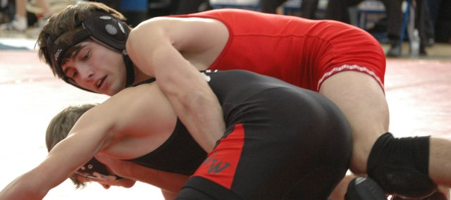 Tonganoxie junior Matt Brock battles with Tim Wright of Jefferson West on Feb. 15 at the 4A regional in Perry.