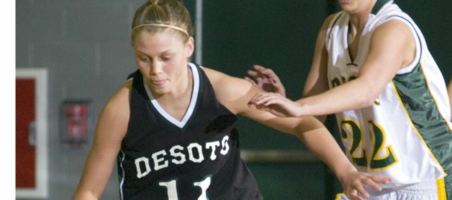 Tami Crow tries to avoid the defense in De Soto's sub-state game against Basehor-Linwood. The Wildcats lost, 66-36.