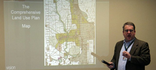 Leavenworth County Planning and Zoning director Chris Dunn fields questions about the county's comprehensive land use plan that was summarized in a public meeting Tuesday, Feb. 19, at Community National Bank in Basehor. Planning and zoning staff, volunteers with a comprehensive plan committee and planning consultants with Ochsner Hare & Hare have worked for months to create the plan, which will guide future growth and development in the county.